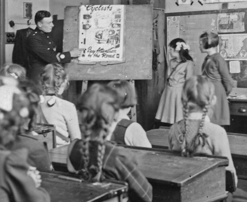 Policeman in a classroom Philip Howard Flickr